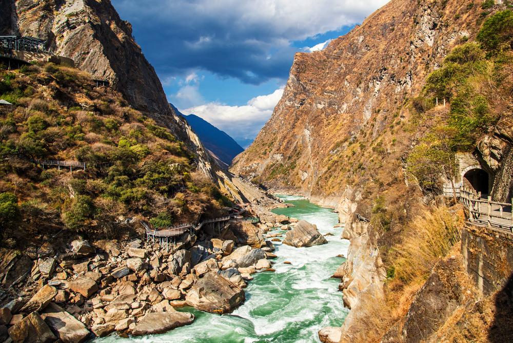 rocky river running through a canyon