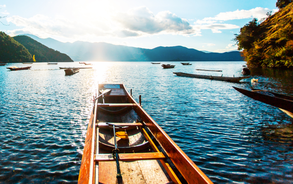 wooden boats on calm blue lake