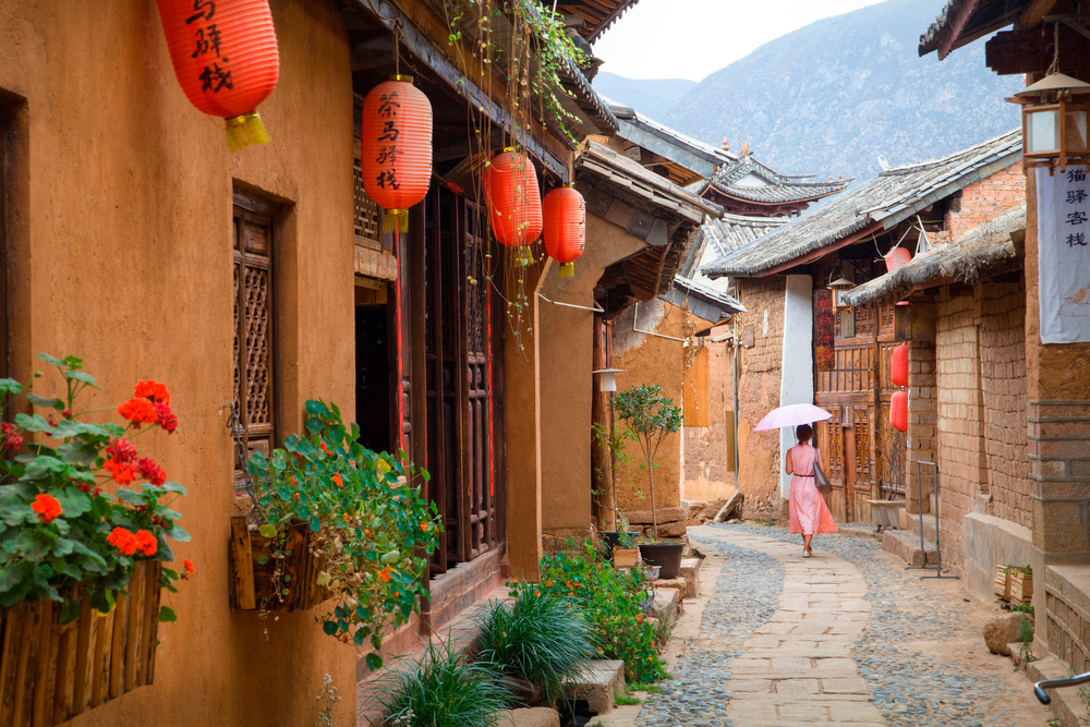 quaint traditional town with chinese lanterns lining the street