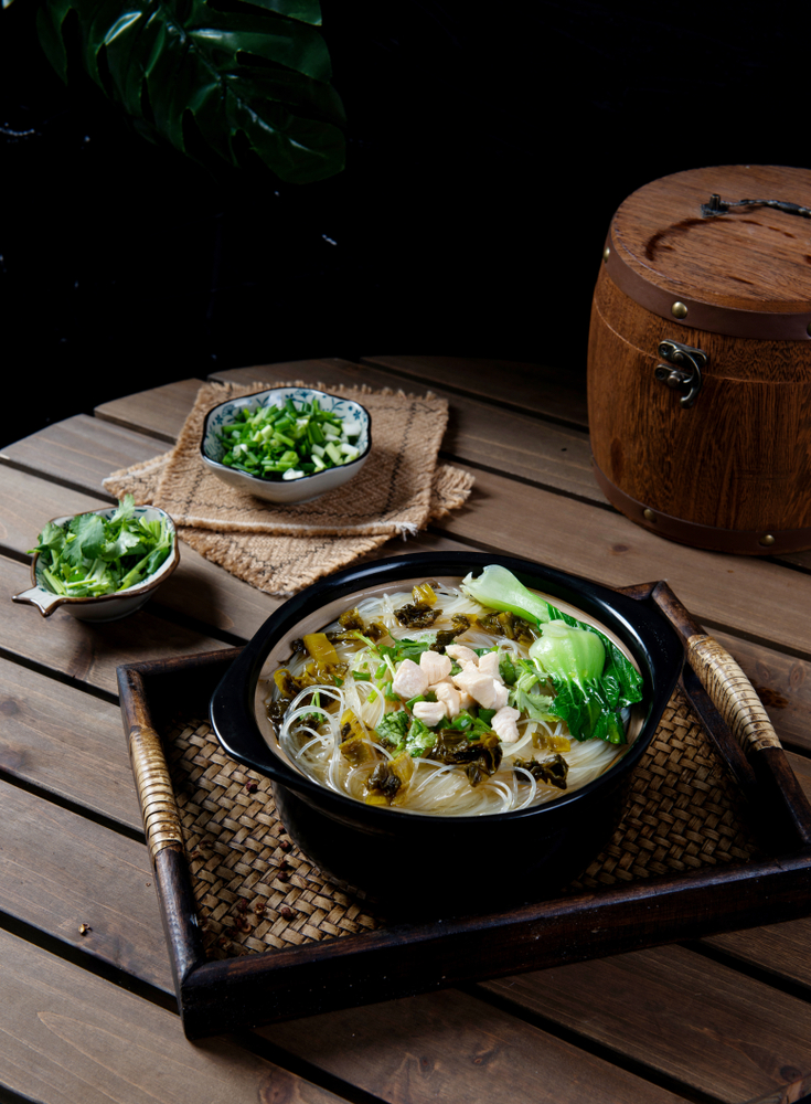 table set with rice noodle soup