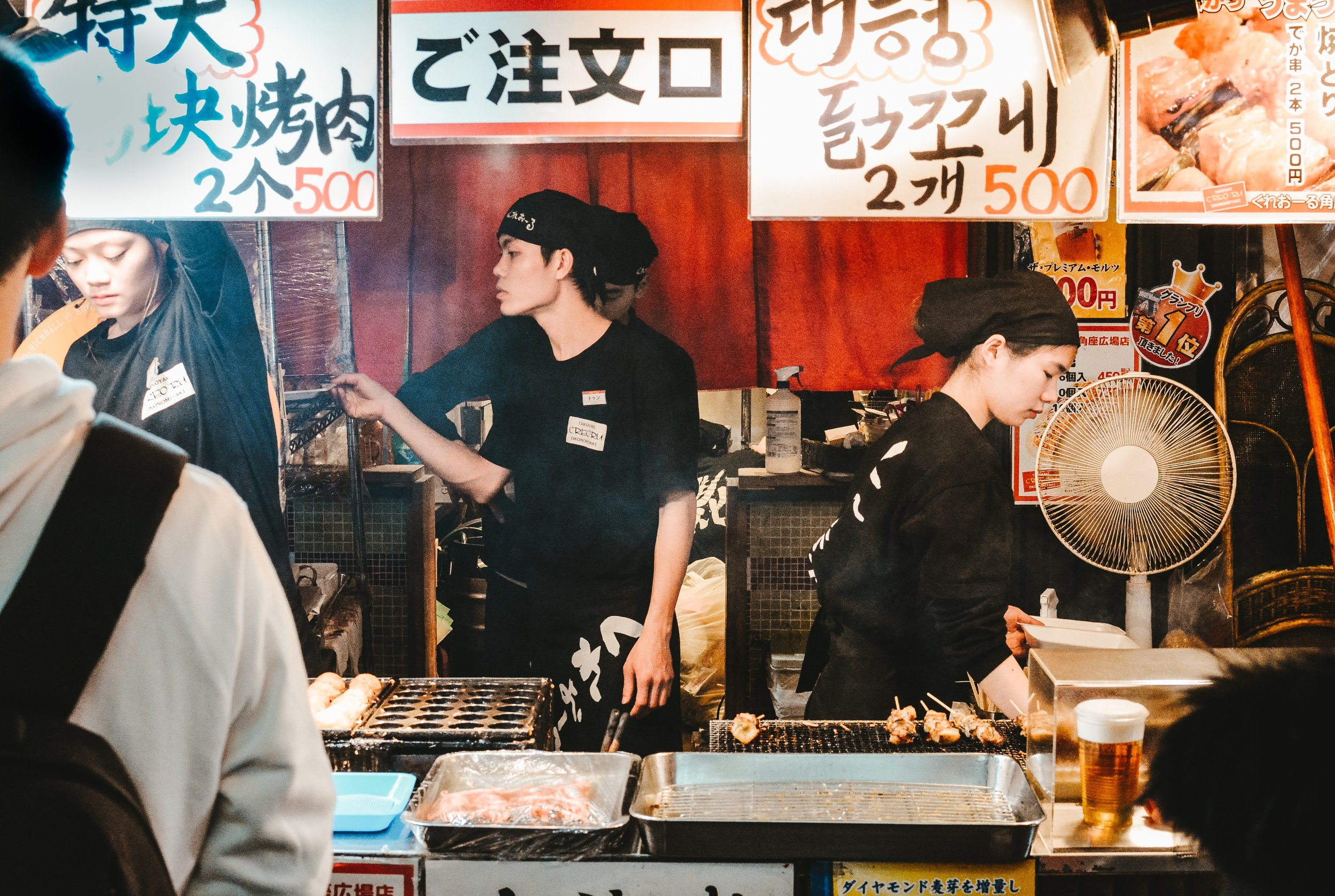 busy japanese food stand with chefs