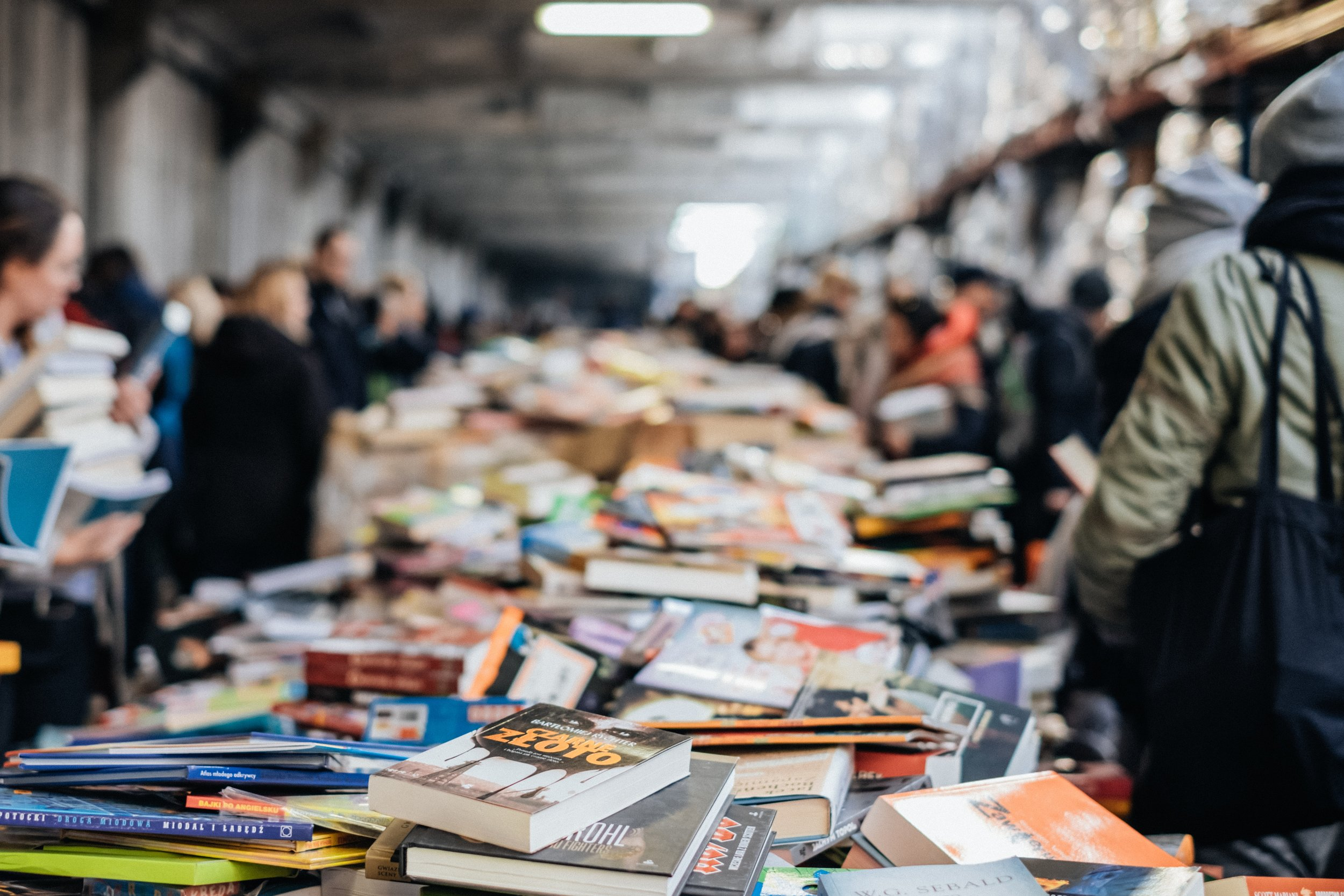 piles of books at a book sale