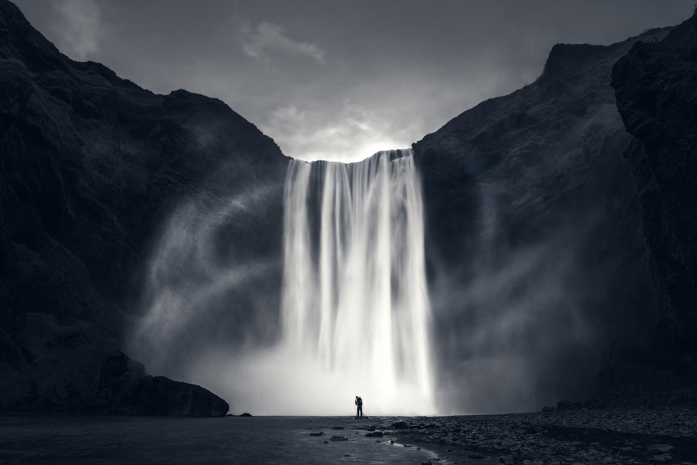 skogafoss iceland waterfall amazing wind cloudy dramatic.jpg