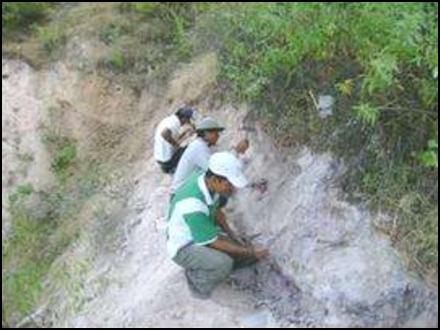 Sampling along a hand-cut trench.