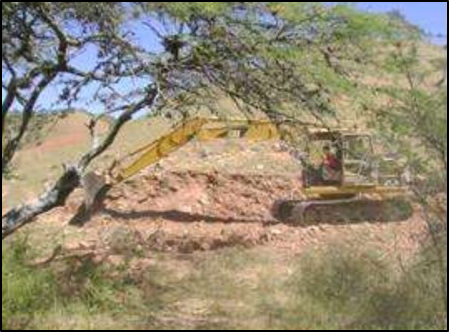 Digging of trenches with an excavator.