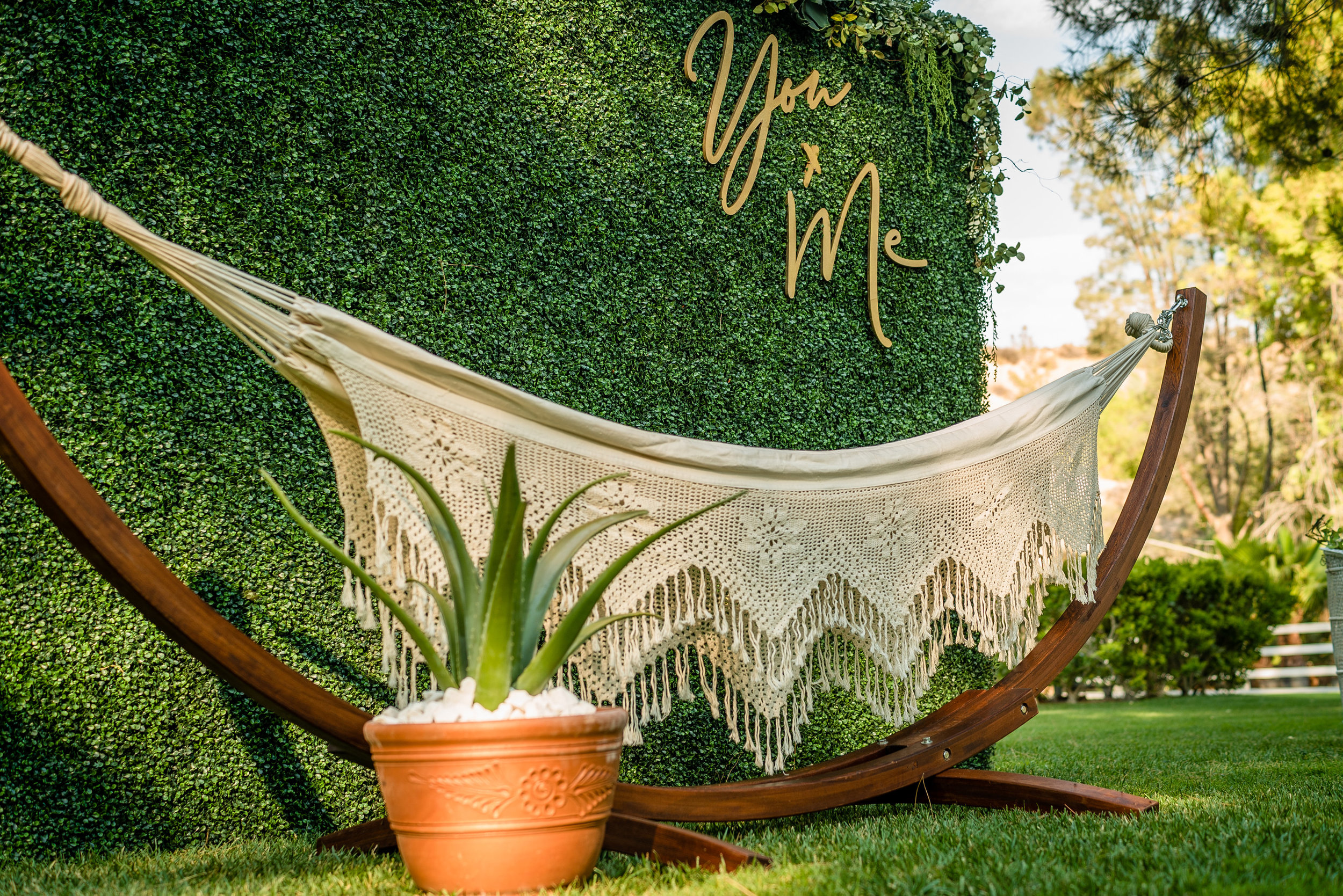 Styling & Set-up:  Eyesome Events  | Signage:  Unshakably Unique  | Hammock:  Ten Four Decor  | Photo:  Super Million Visuals