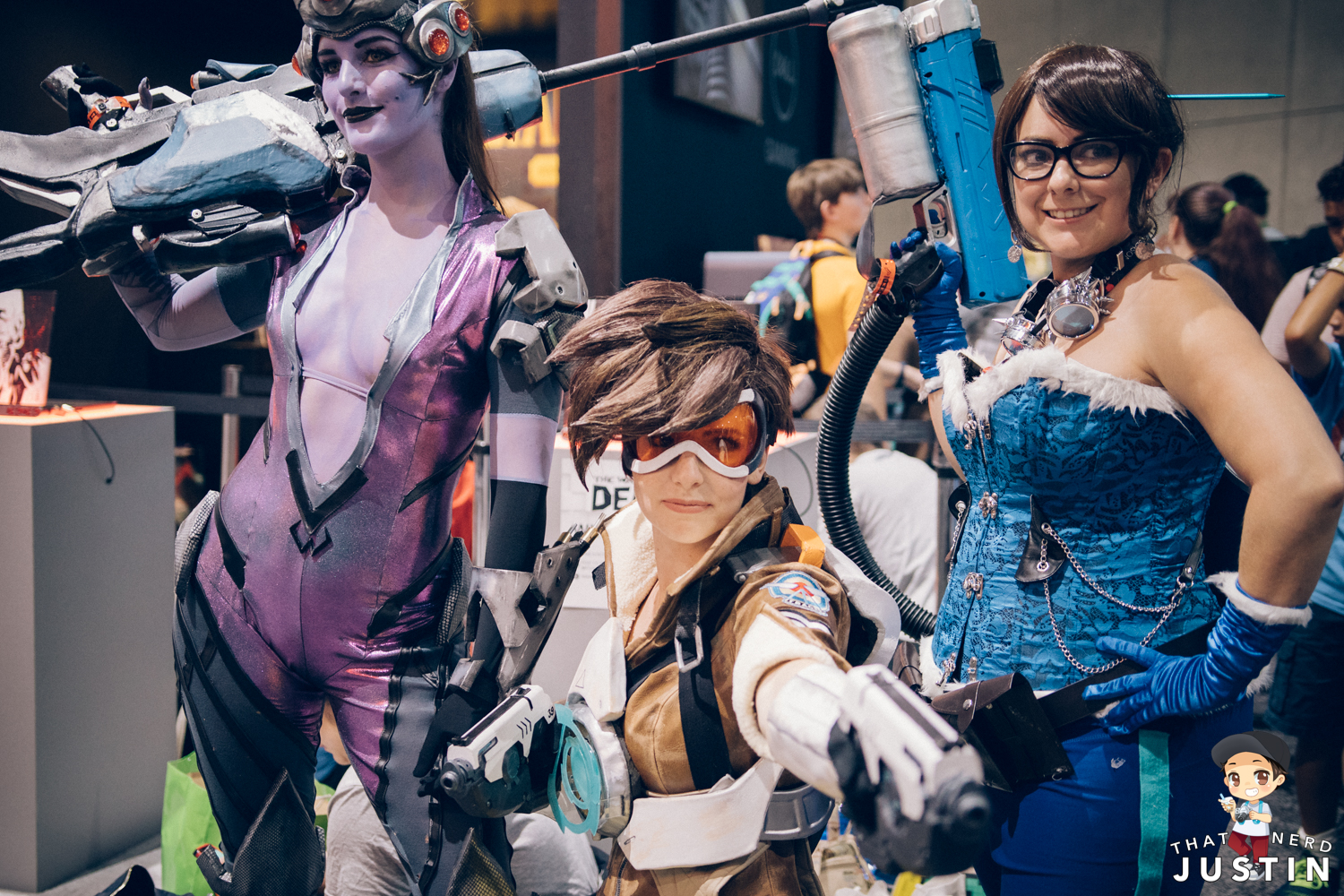 Widowmaker, Tracer, and Mei cosplayers near the Blizzard booth.