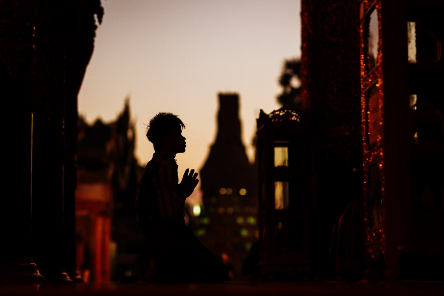 A local man at morning prayer in Yangon, Myanmar.