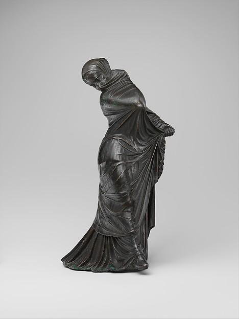 Bronze statuette of a veiled and masked dancer,  Metropolitan Museum of Art