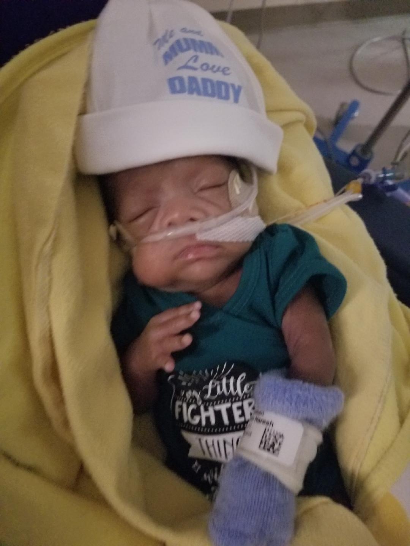 Premature baby boy sleeping