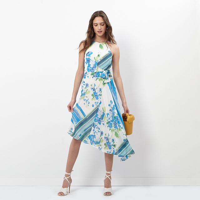 Brave the summer heat and look great doing it in our asymmetrical chiffon floral dress. Available now on Amazon and Zappos. Link to shop here and in our bio: https://amzn.to/2XZpQdL #donnamorgan_nyc #newnessfashion #daytonightfashion #effortlessfashion #summercollection2019 #guestofwedding #workwear #outfitoftheday #highstreetfashion #whattowear #effortlessstyle #daytonightdress #fashioncollection2019 #fashiondaily #dailystyle #casualchic #everydaystyle #affordablestyle #9to5style #classystyle #streetstyle #workstyle #guestofawedding #corporatestyle #daytonightstyle  #islandelegance #newarrivals #gardenparty #prefallcollection2019