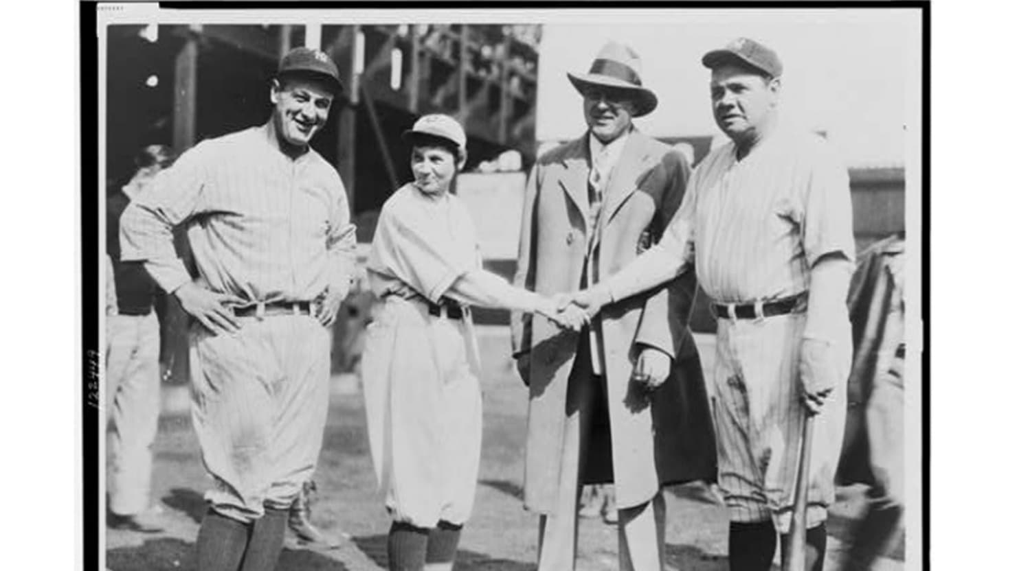 Pitcher Jackie Mitchell shaking hands with Babe Ruth, while Lou Gehrig (left) and Joe Engel stand by,    1931 (Library of Congress)
