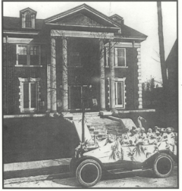 "Abby Crawford Milton is shown in a decorated car with suffrage supporters, as well as her three children, in front of her home in Chattanooga. (""The Thrill of History Making: Suffrage Memories of Abby Crawford Milton"" in the Tennessee Historical Quarterly)"