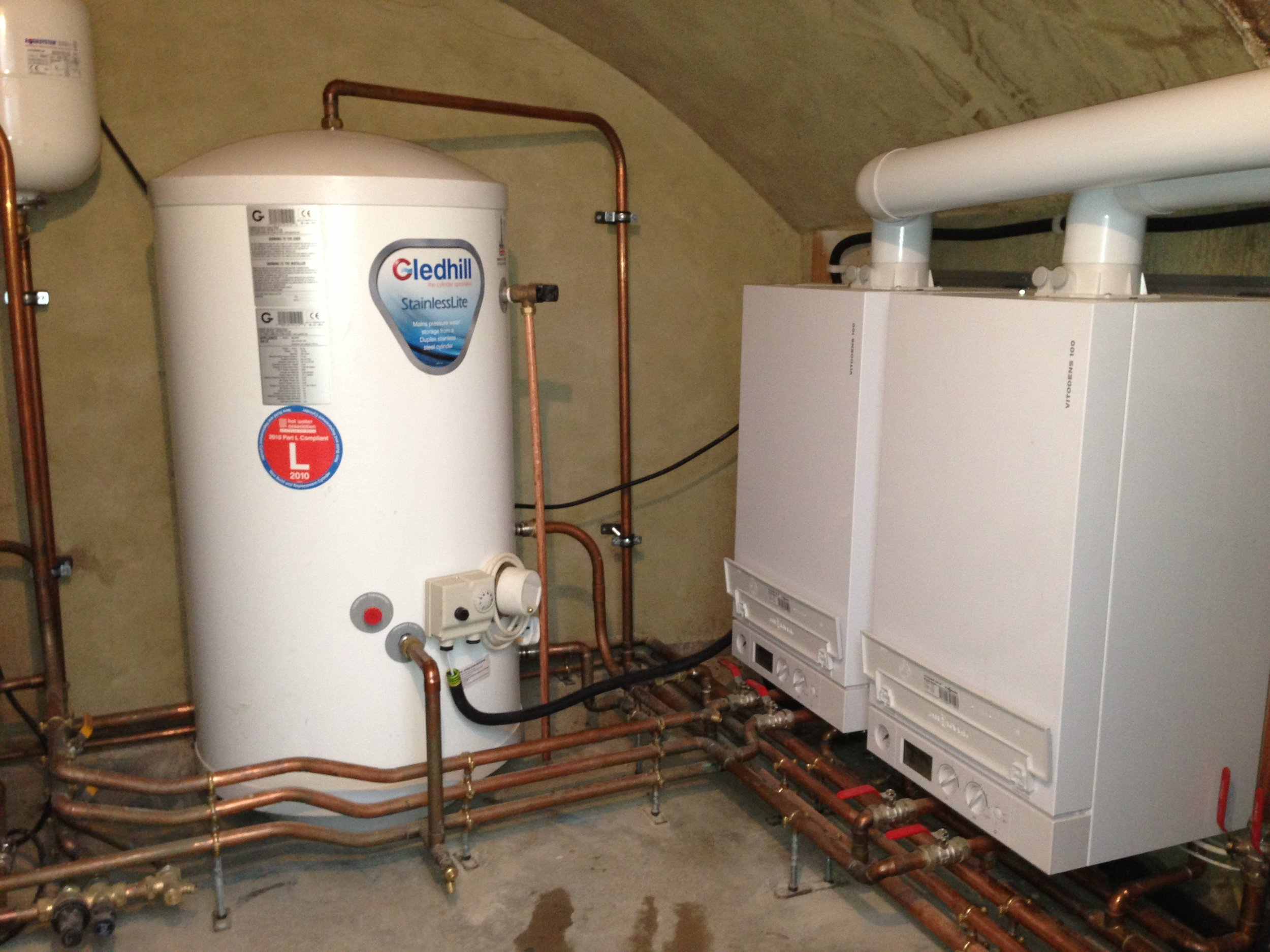 Replacement of two Keston C30 boilers with two Veissmann Vitodens 100w 35kw boilers along with two DHW cylinders and a Grundfos 180l home booster with a 180l slave tank.JPG