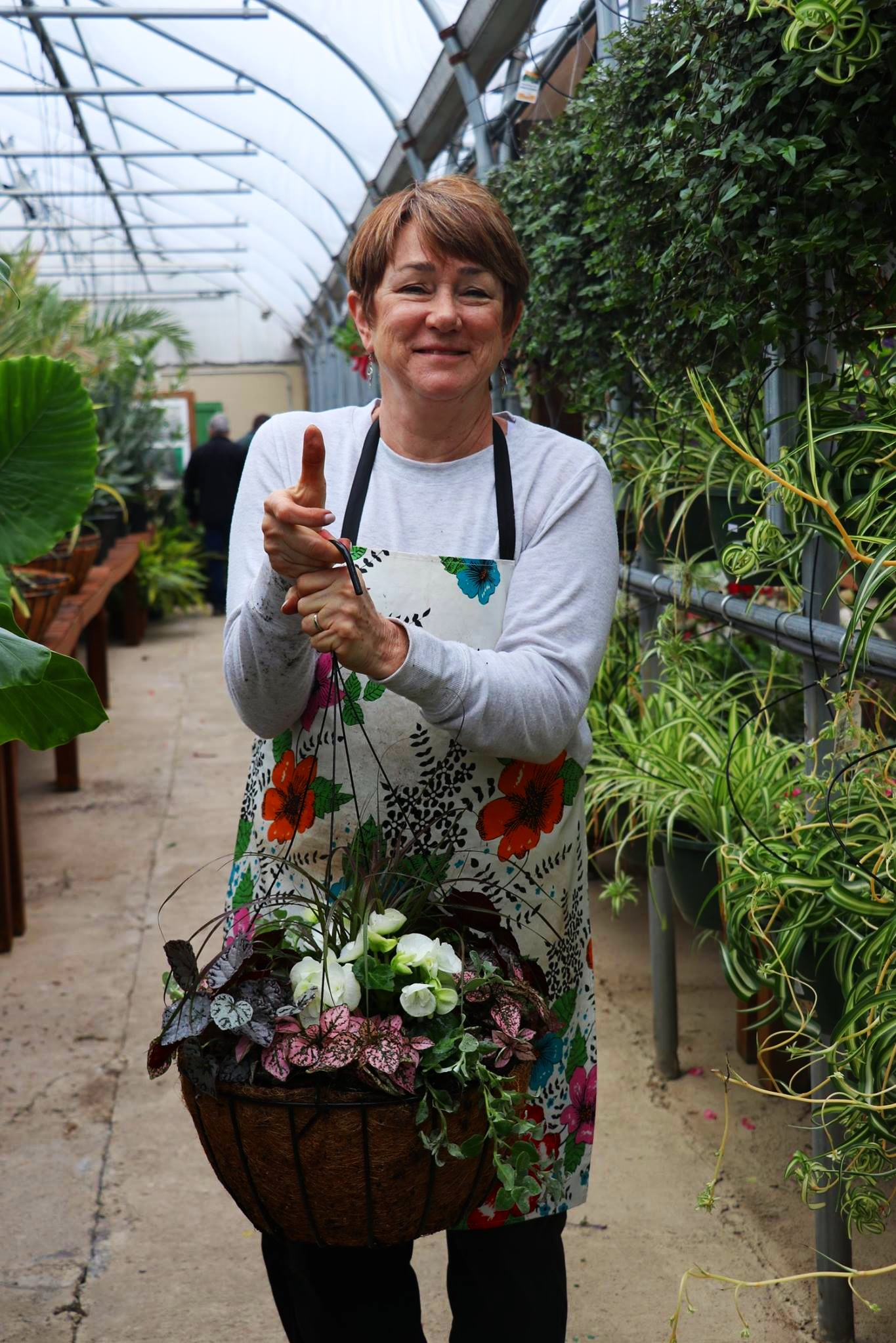 Mary - Known for her famous hanging baskets, Mary uses her passion for gardening and experience in garden and landscape design to create gorgeous arrangements. With her strong background in design, she does a wonderful job of making containers that are just drop dead gorgeous!