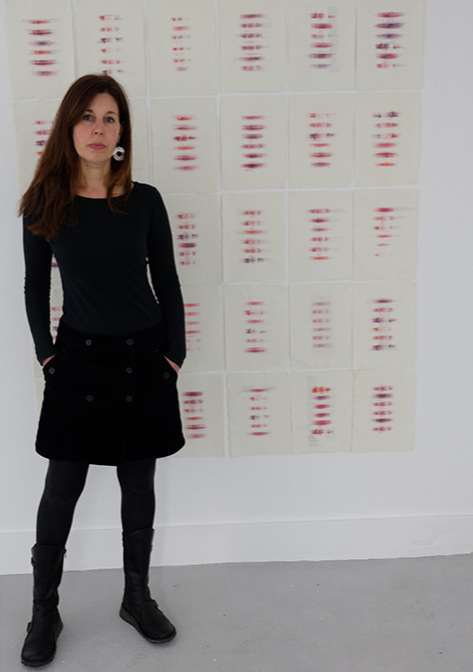 Kate Southworth in front of Installation of  64 Telepathic Moments.   Photograph by Neil McLeod