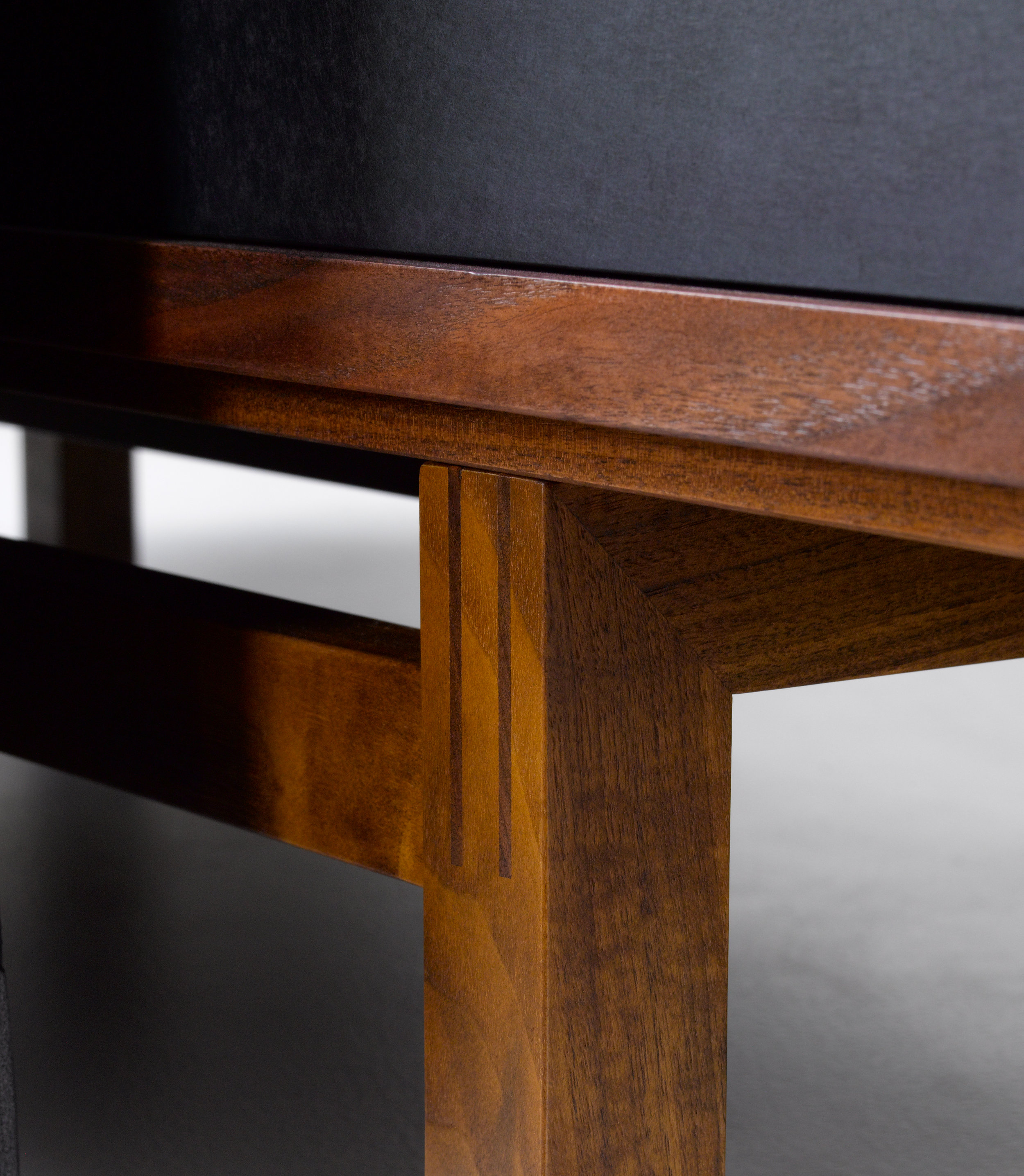 > Detail of joinery at Credenza base.