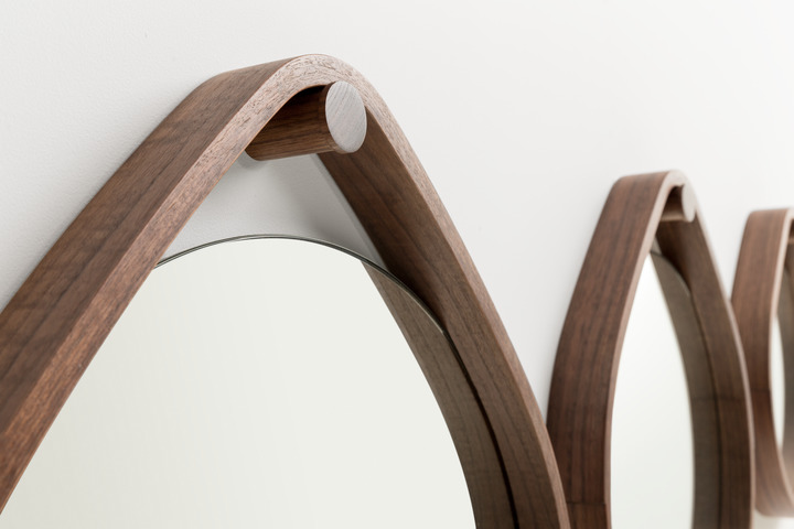 >Detail of laminated frame on turned wall peg.