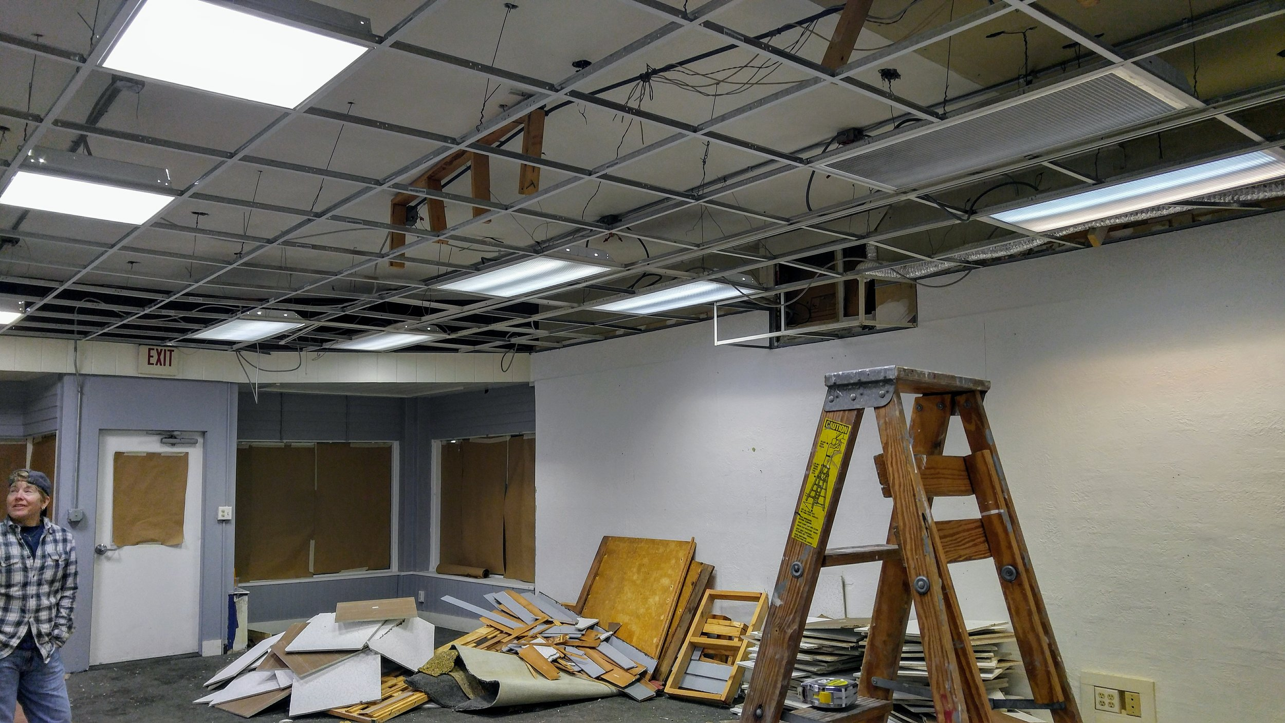 The removal of ceiling tiles opened the space up to reveal another two feet in overall height.