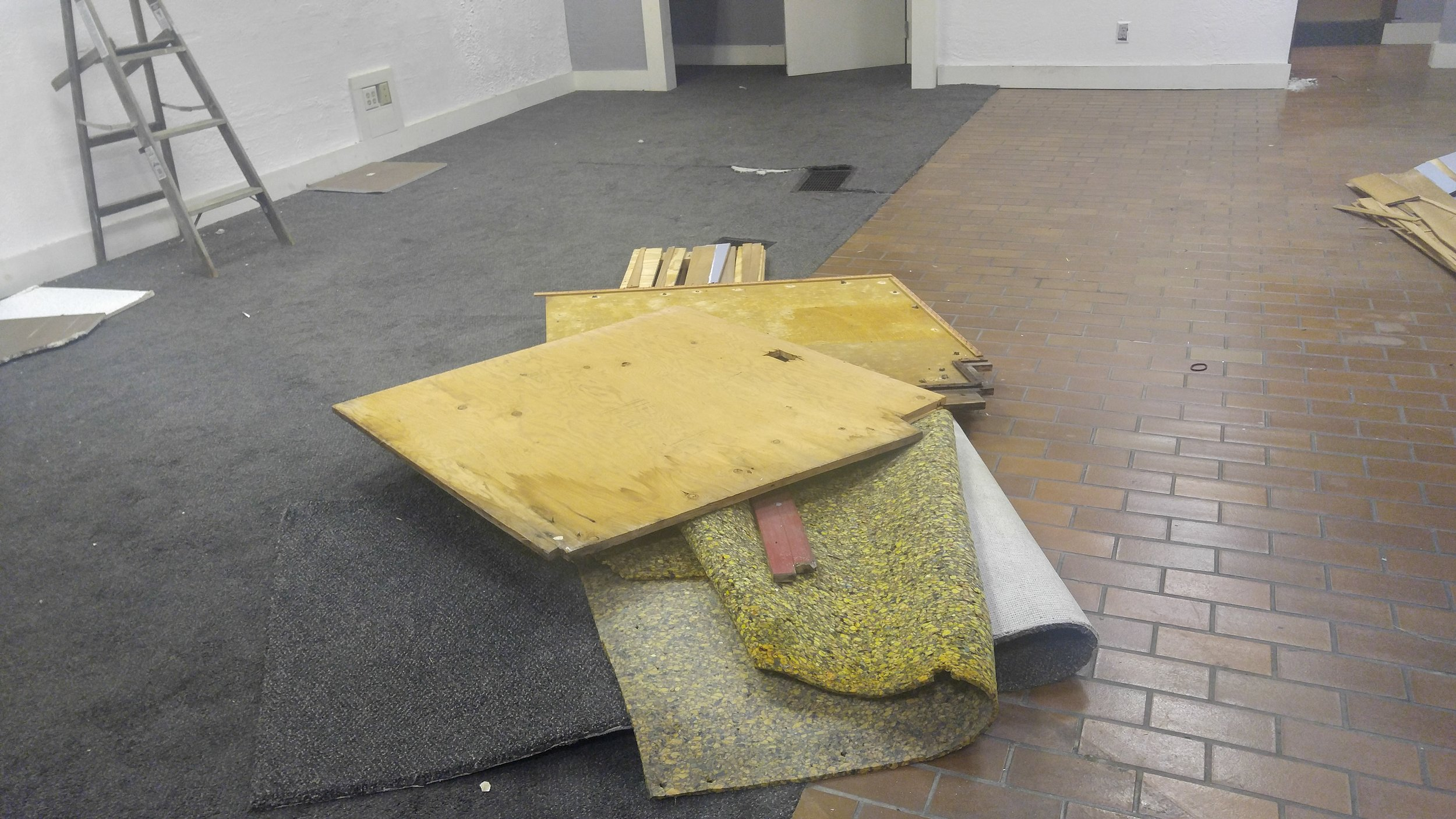 Removal of a window display platform. Seating will be built in its place.
