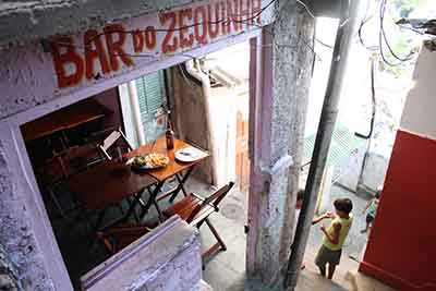 Favela dining in Rio - Rio de Janeiro's favelas have long been lawless no-go zones – but now that some have driven out the drug gangs, their restaurants are attracting increasing numbers of tourists.The Guardian, May 2014