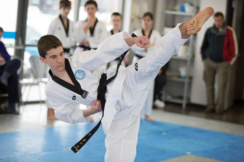 martial arts student doing a side kick