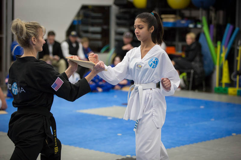 taekwondo student breaking a board