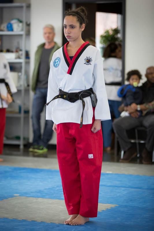disciplined girl practicing taekwondo
