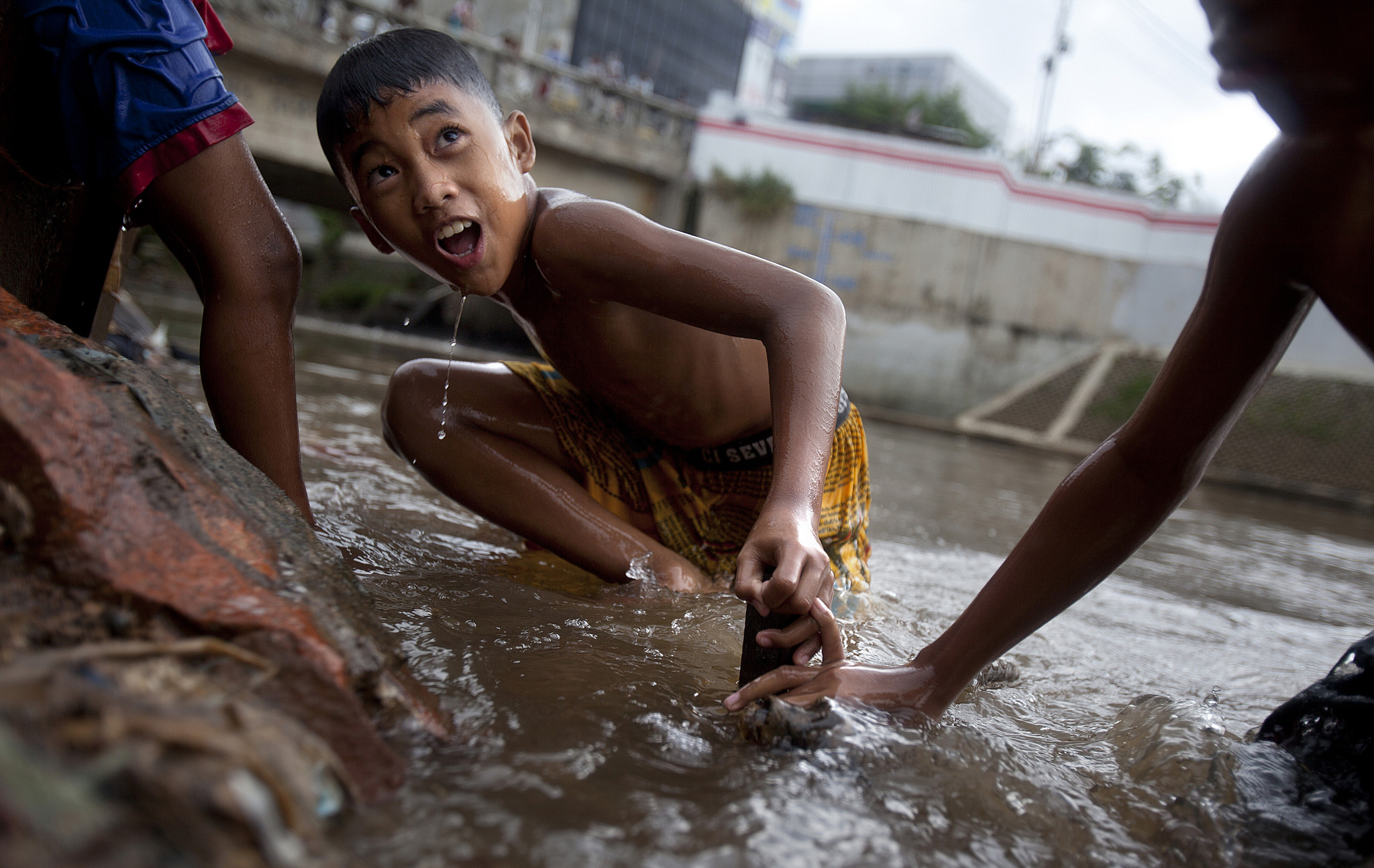 A boy swims in Jakarta's Ciliwung River.