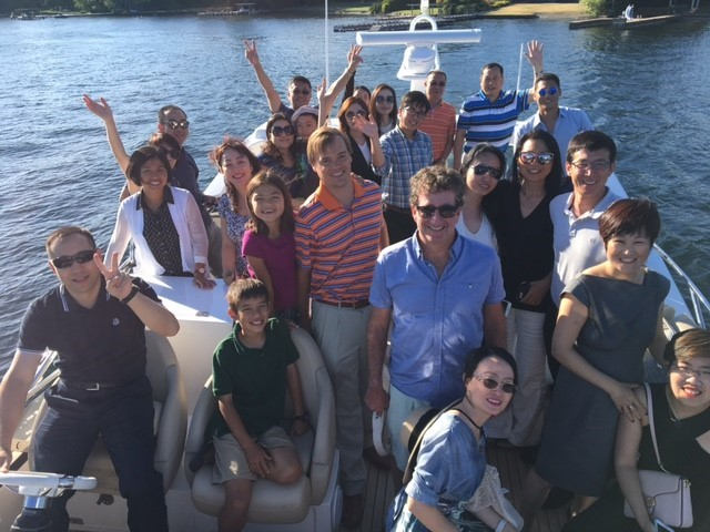 Above: A recent waterfront tour hosted by Realogics Sotheby's International Realty welcomed a delegation of Chinese investors and developers to experience Lake Washington.