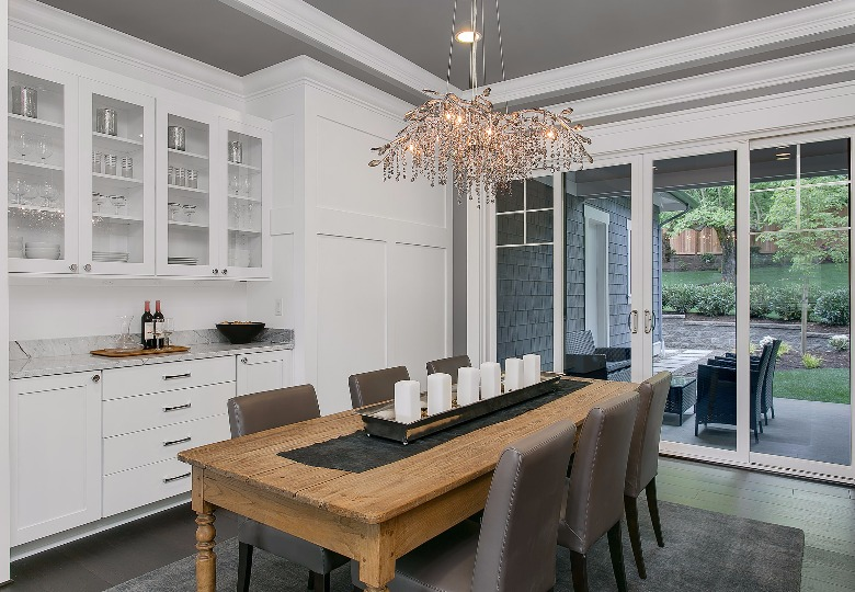 The chandelier's mystic silver finish with smoked glass is mesmerizing and elegant. Lighting is the perfect opportunity to show off your personality. Image Credit: HD Estates