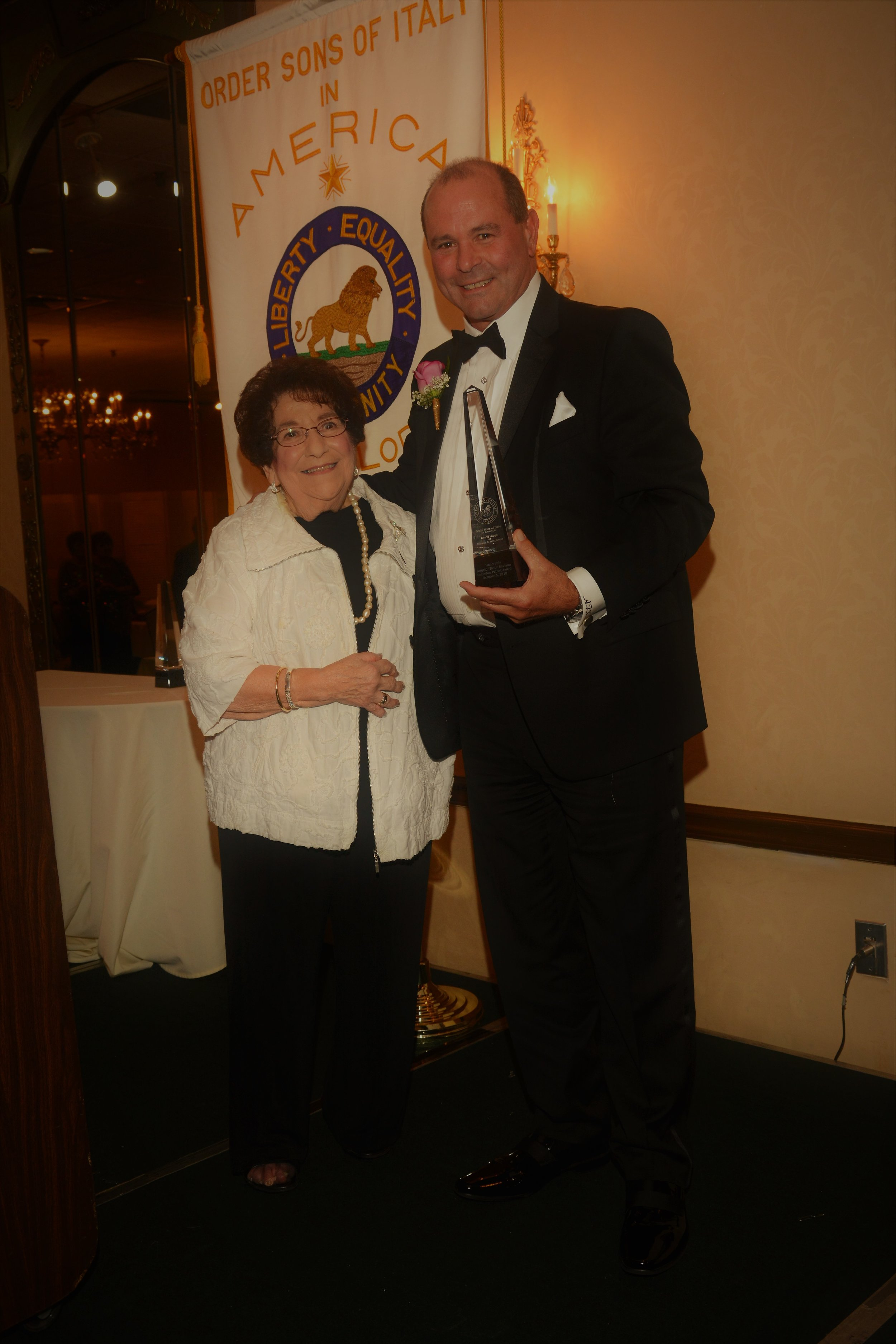 """- Receiving the Columbus Patriot Award was the Honorable Angelo """"Skip"""" Saviano, President of the Village of Elmwood Park, Illinois. He has been a proven and trusted leader in the Elmwood community for over 25 years. He was honored for his many years of public service and leadership in the Illinois House of Representatives, where he recently retired as Assistant Minority Leader.He has sponsored and supported legislation to aid the elderly, children and people of all backgrounds. Saviano is known as a staunch advocate for senior citizens and individuals with special needs. He is recognized as a champion for individuals diagnosed with Autism Spectrum Disorder. He is a strong supporter of public safety."""