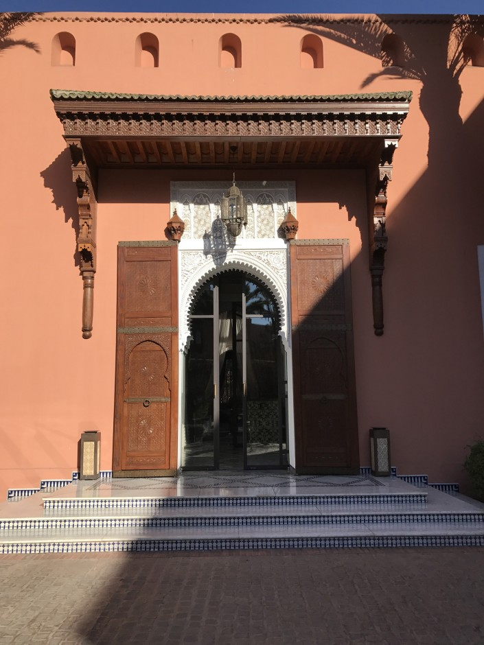 """Playing in the sun and admiring the doorways at Royal Mansour."""