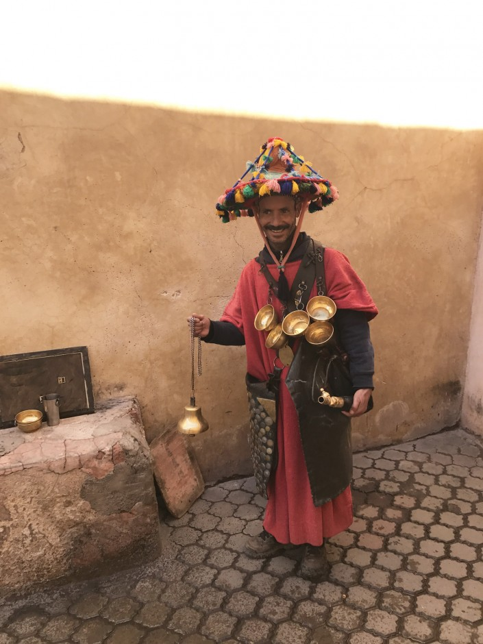 """A new friend outside of the hotel. Our guide told us that he was dressed in traditional Berber attire, and his role in the Medina is to provide water for people throughout the day. Known locally as a fixture and roughly translated into 'Waterman.' We said hi to him every morning."""