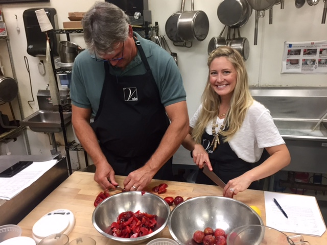 Paul and Katie pitting plums