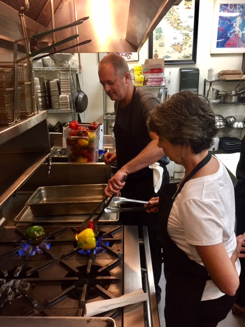 Chef Paul and Lori blistering sweet peppers