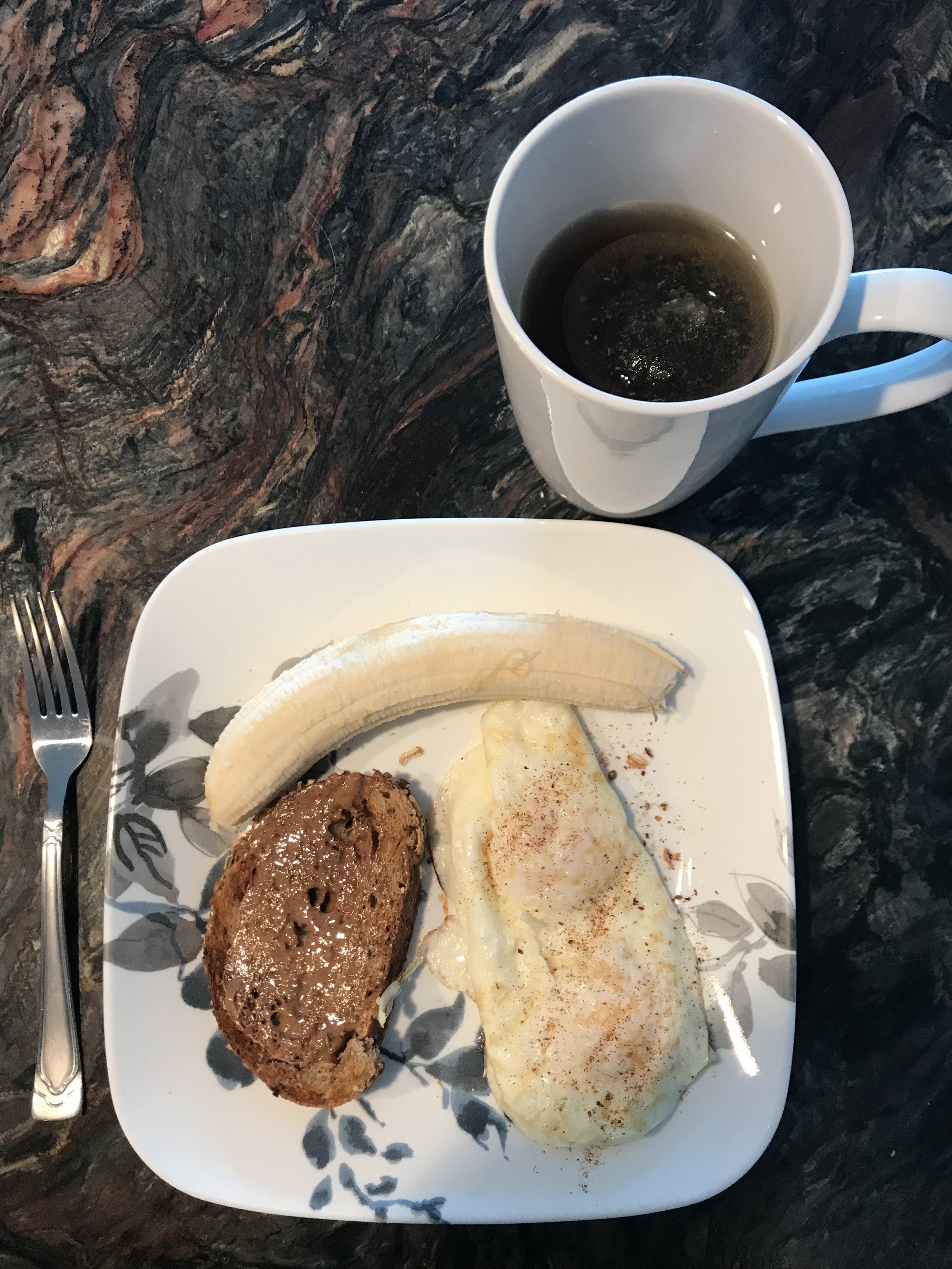 BREAKFAST - 2 fried Eggs, Banana, Almond Butter on Whole Grain Bread. Tea.