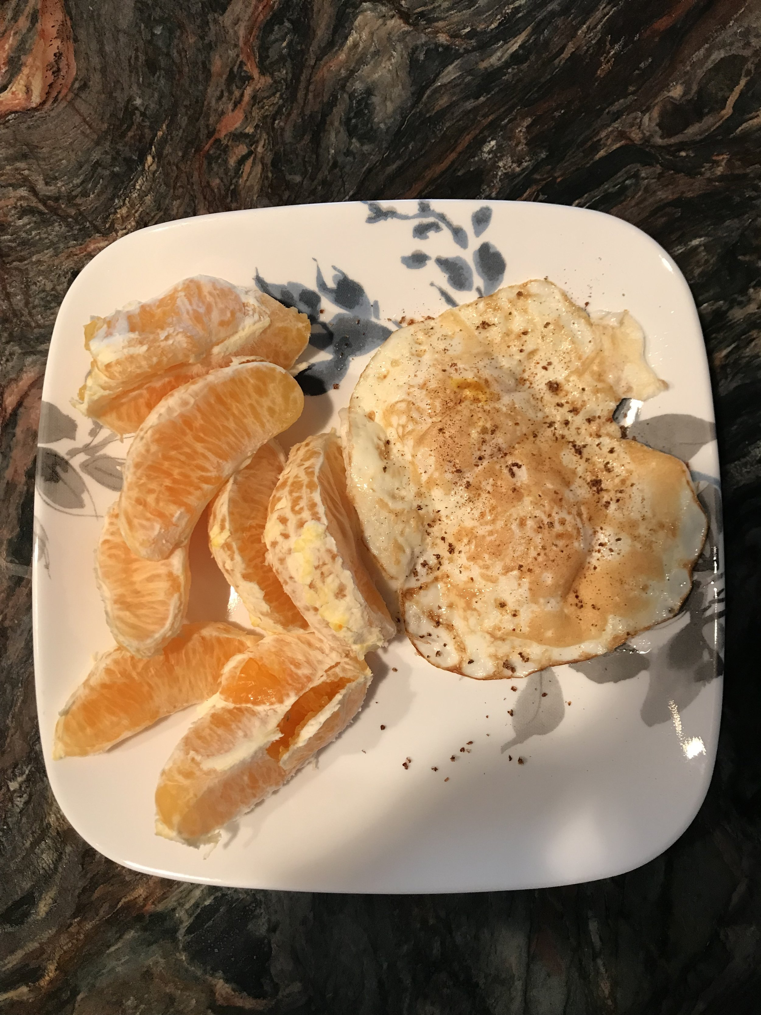 BREAKFAST - 2 Fried Eggs, and only ate about 1/4 of the Orange (it was dry).