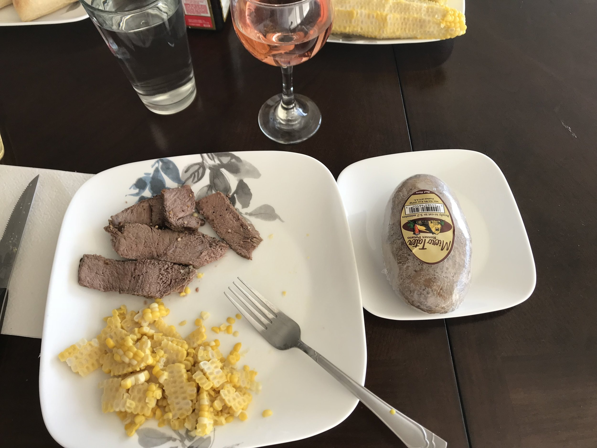 DINNER - Roast Sirloin Beef, Corn on the Cob, baked Potato (1/2 half), 1/2 a French Roll, and a glass of Wine. Ended the evening with a slice of Key Lime Pie.