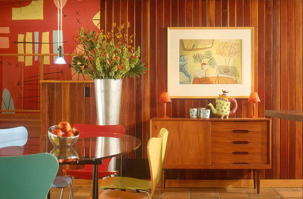 The dining area shows the beautiful original redwood tongue and groove paneling. It had been painted avocado green, with a gold ceiling. Citrus stripper (and lots of elbow grease) worked miracles. Beam and ceiling were painted to look like they had been stained; being too-soft to refinish with decent results.