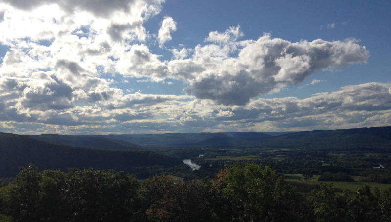 View of Finger Lakes region from high upon a hilltop overlooking part of a lake