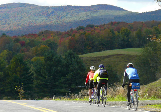 Bicycle riders with colorful Fall trees