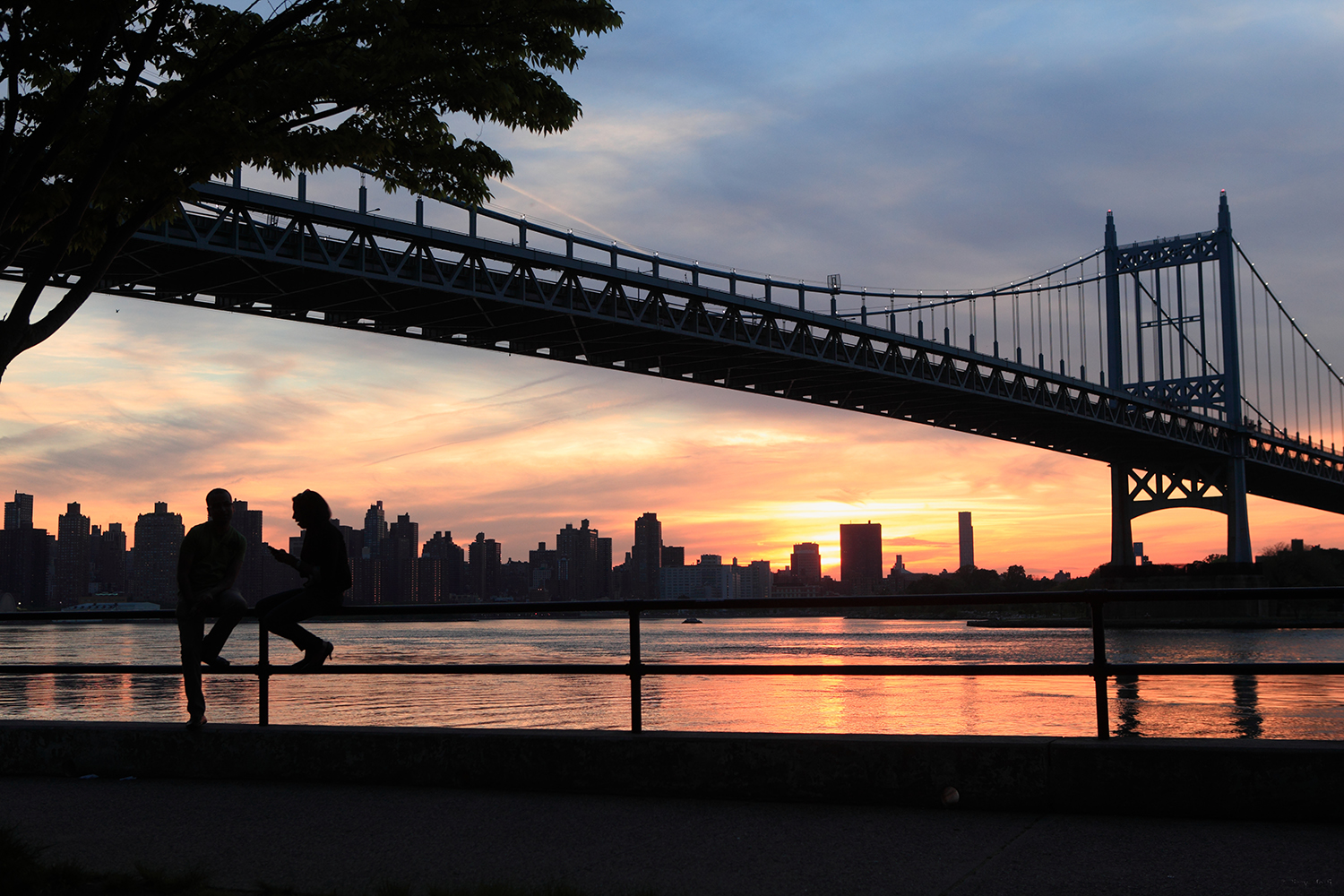 U.S.A. / New York / View of the sunset at Triborough bridge