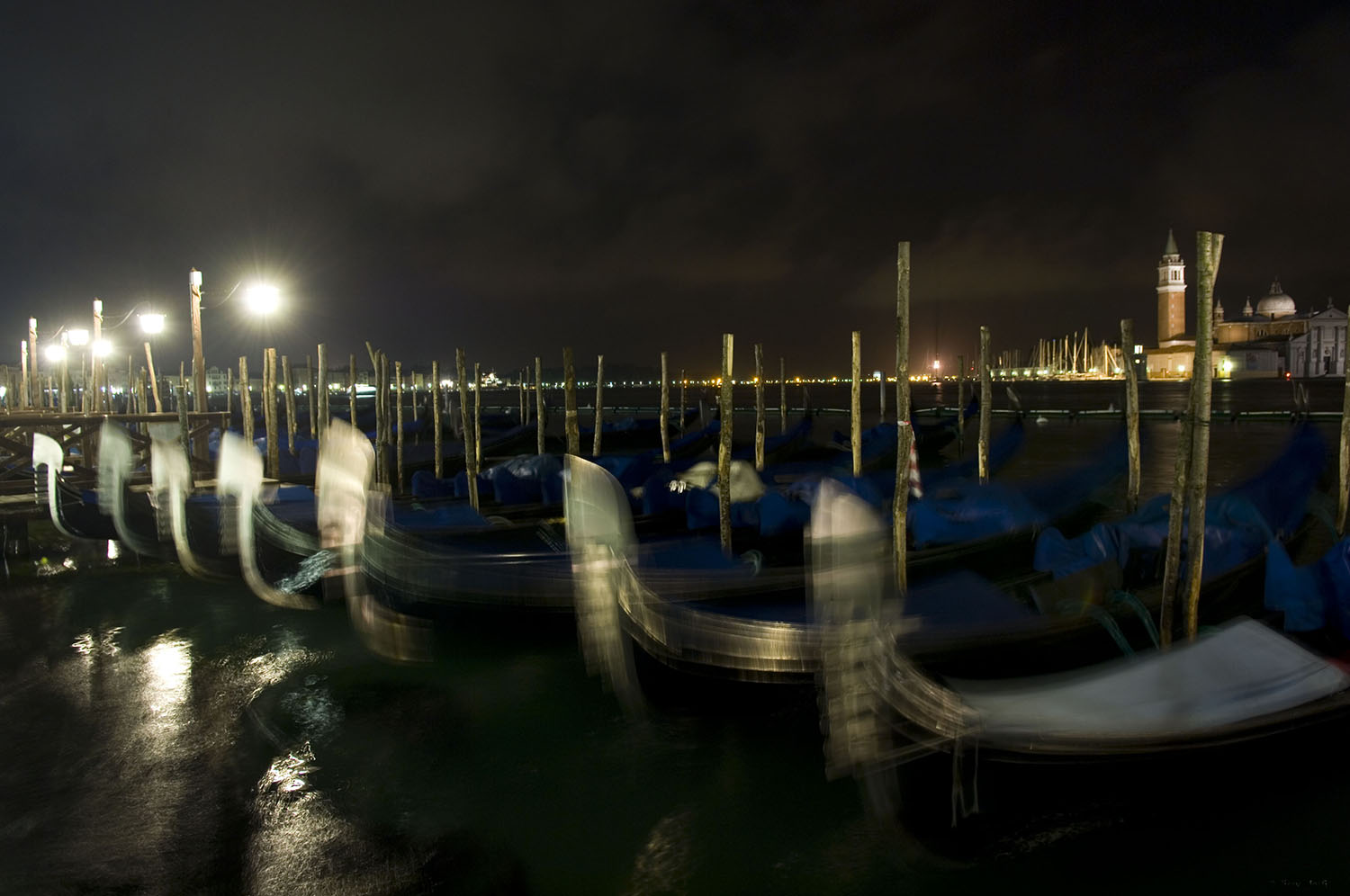 Italy / Venice / Dancing gondolas by night