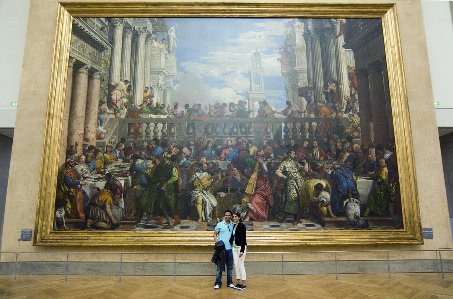 """France / Paris / Louvre / Couple posing  in front of the painting """"The Wedding Feast at Cana"""", inside the """"Mona Lisa room"""""""