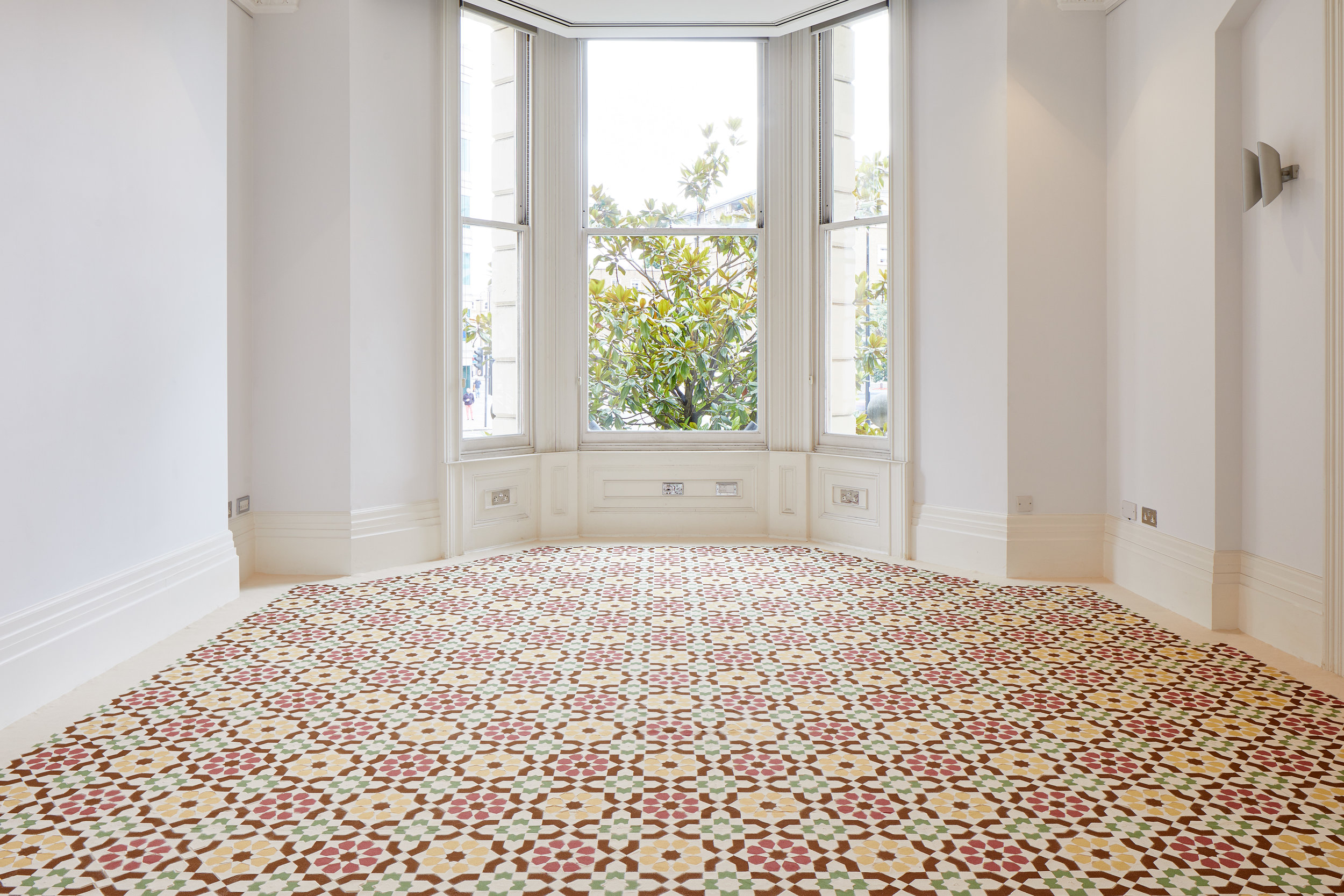 I went away and forgot you. A while ago I remembered. I remembdered I'd forgotten you. I was dreaming. Installation of hand dyed sand (2017) by Dana Awartani. Photo by Andy Stagg. Courtesy of The Mosaic Rooms.