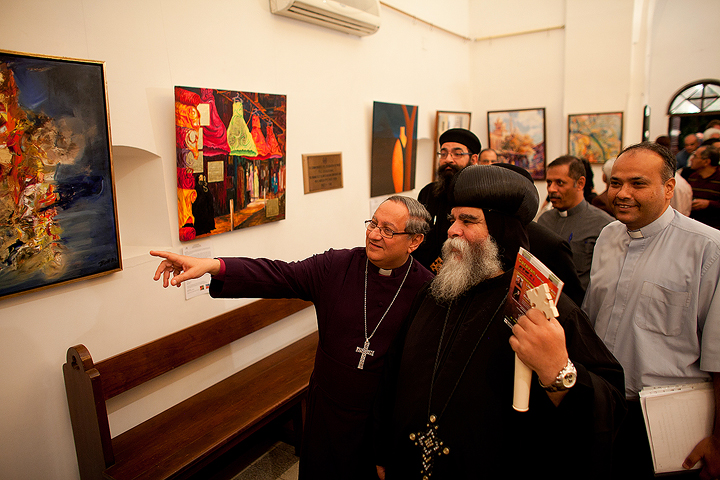 Anglican Bishop Mouneer Anis showing Coptic Bishop Botros the opening of the Caravan exhibition in 2011 in Cairo. Image courtesy of CARAVAN