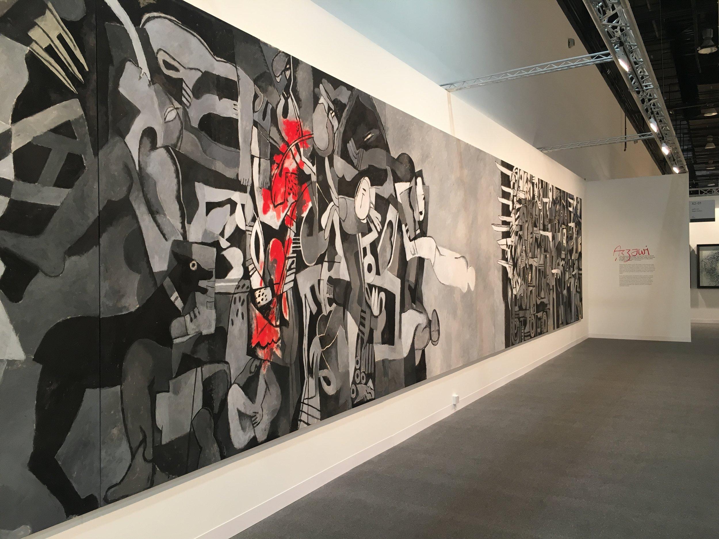 Dia Azzawi. Mission of Destruction. 2004–2007.Acrylic on canvas,200cm x 1500cm. Image taken by Anna Seaman at Abu Dhabi Art, 2017.