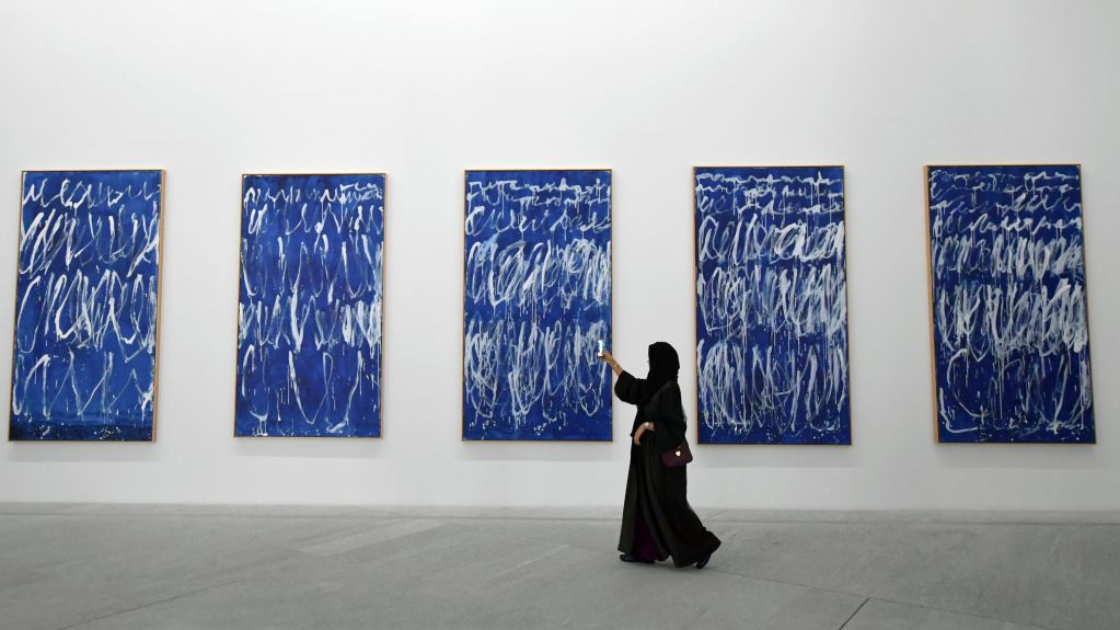 A visitor peruses the Cy Twombly paintings inside the Louvre Abu Dhabi. Image taken by Giuseppe Cacace