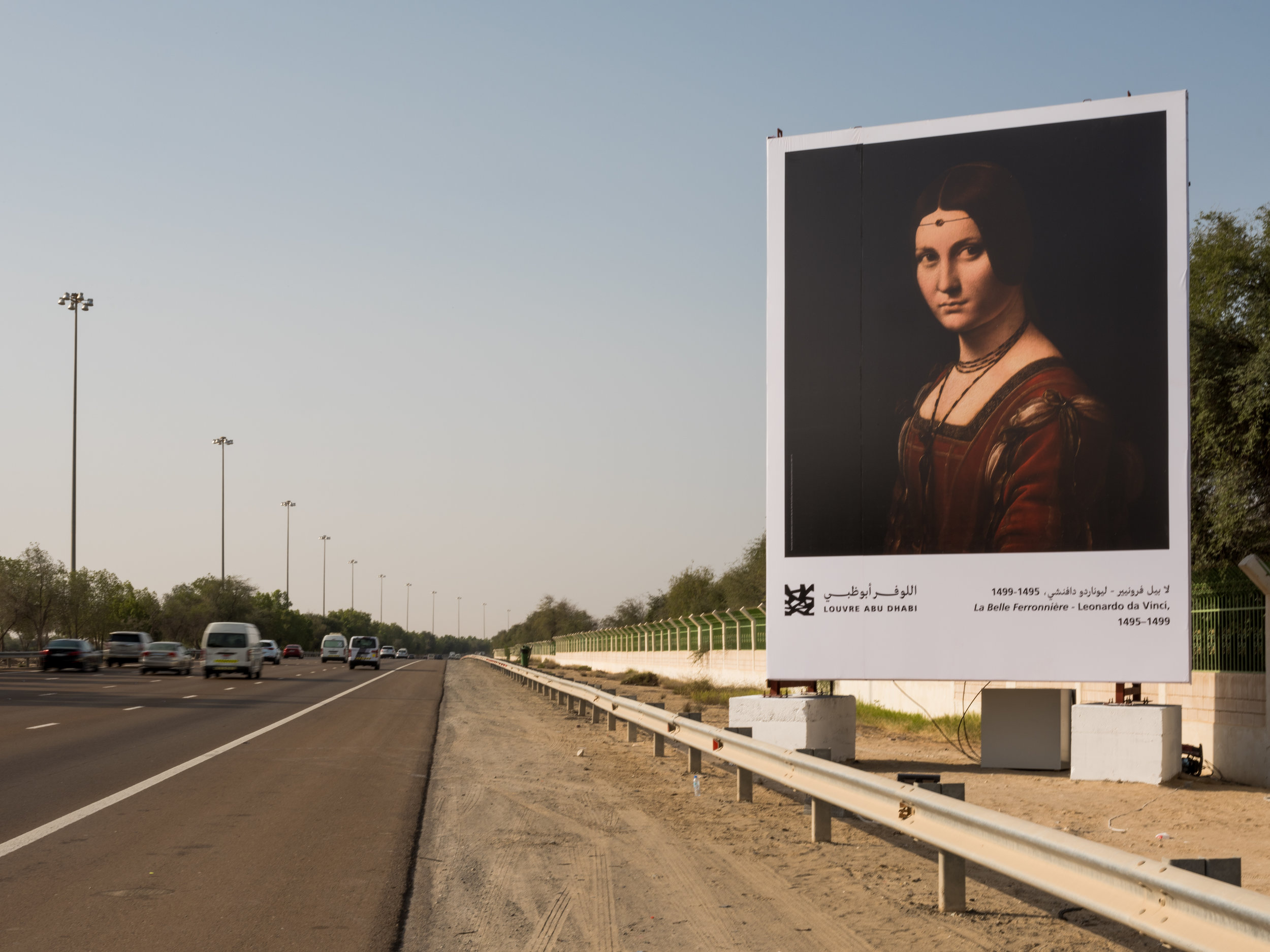 La Belle Ferroniere, Leonardo Da Vinci's masterpiece that is currently hanging in the Louvre Abu Dhabi is one of 10 billboards that trigger a radio introduction to be played to motorists as they drive past. Image courtesy of Louvre Abu Dhabi